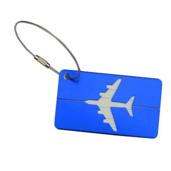 Bőrönd jelölő repülős címke fémből