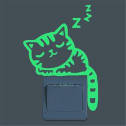 Alvó cica a kapcsolón fluoreszkáló matrica